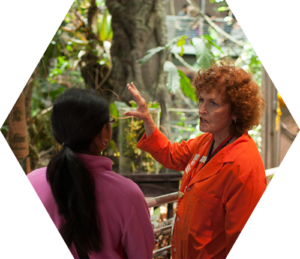 Ca Academy of Sciences staffer talks with a student