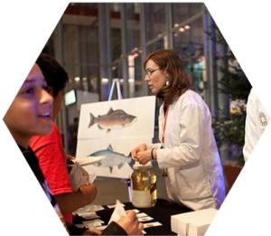 Cal Academy of Sciences staff discuss marine life with students